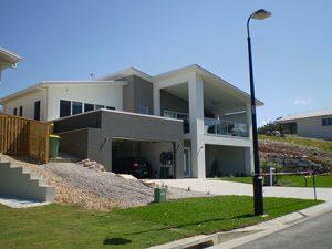 Custom homes split level home design custom home designs for Building a house on a sloped lot